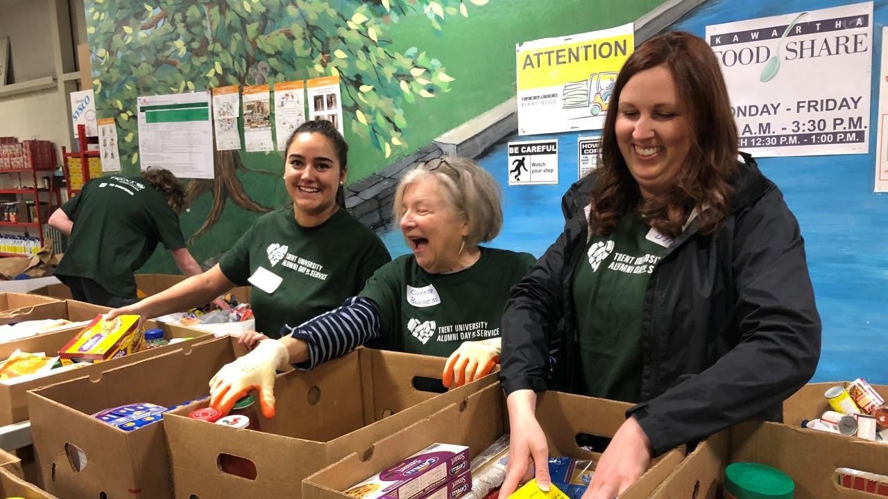 Trent University alumni volunteers sorting food at Kawartha Food Share