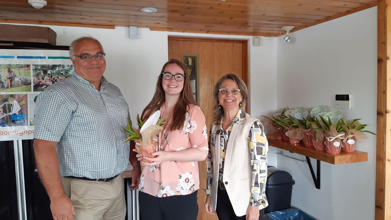 "Bill Gibson, environmental health and safety officer, and Rachel Osborne accept ""Exceeding the Standards Award"" from medical officer of health Dr. Rosana Salvaterra."