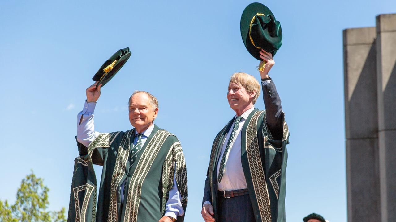 Chancellor Don Tapscott and Incoming Chancellor Stephen Stohn tip their hats at the 2019 convocation ceremonies.