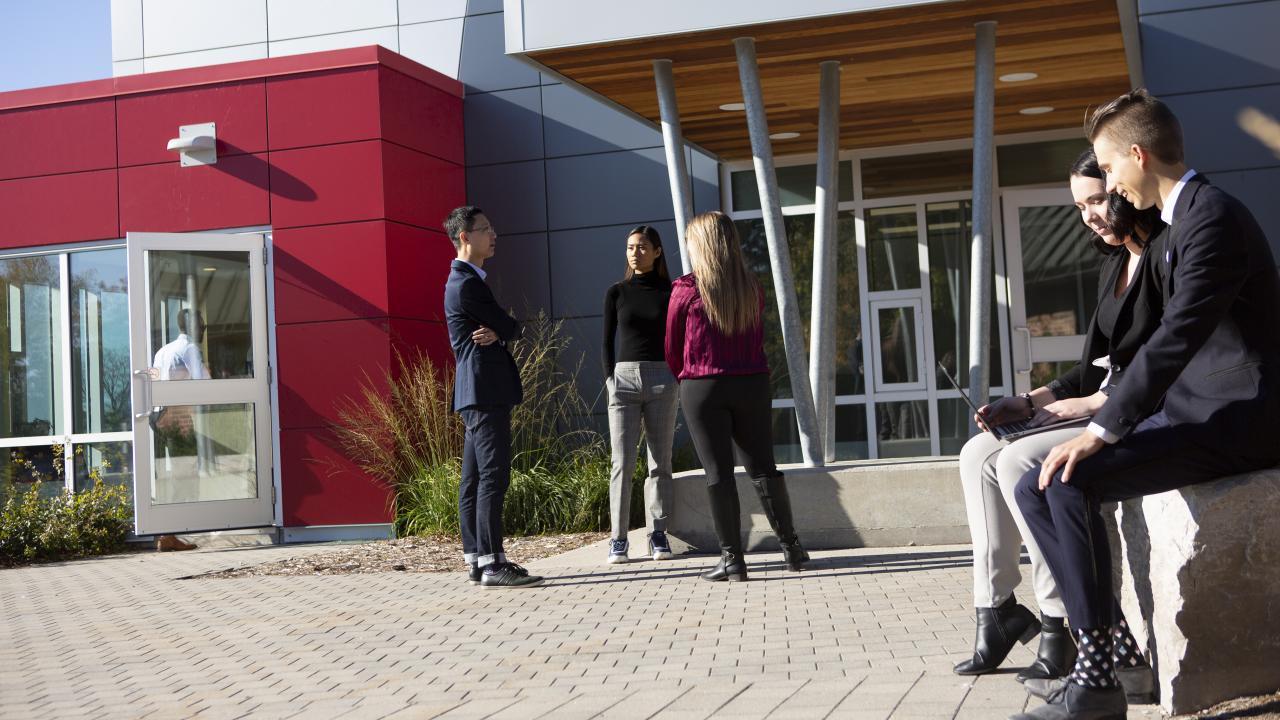 Trent University Durham GTA students conversing outside.
