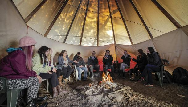 Gathering at the fire in the tipi