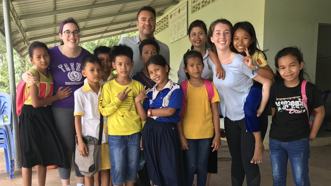 Trent University School of Education students pose for a photo with students in Cambodia as part of their alternative settings placement.