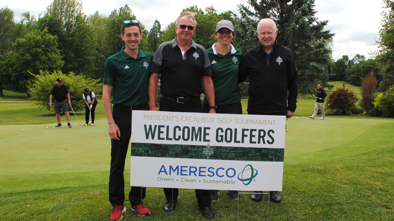 Trent VP Steven Pillar and the Ameresco President Robert McCullough pose for a photo with students at the President's Excalibur Golf Tournament.