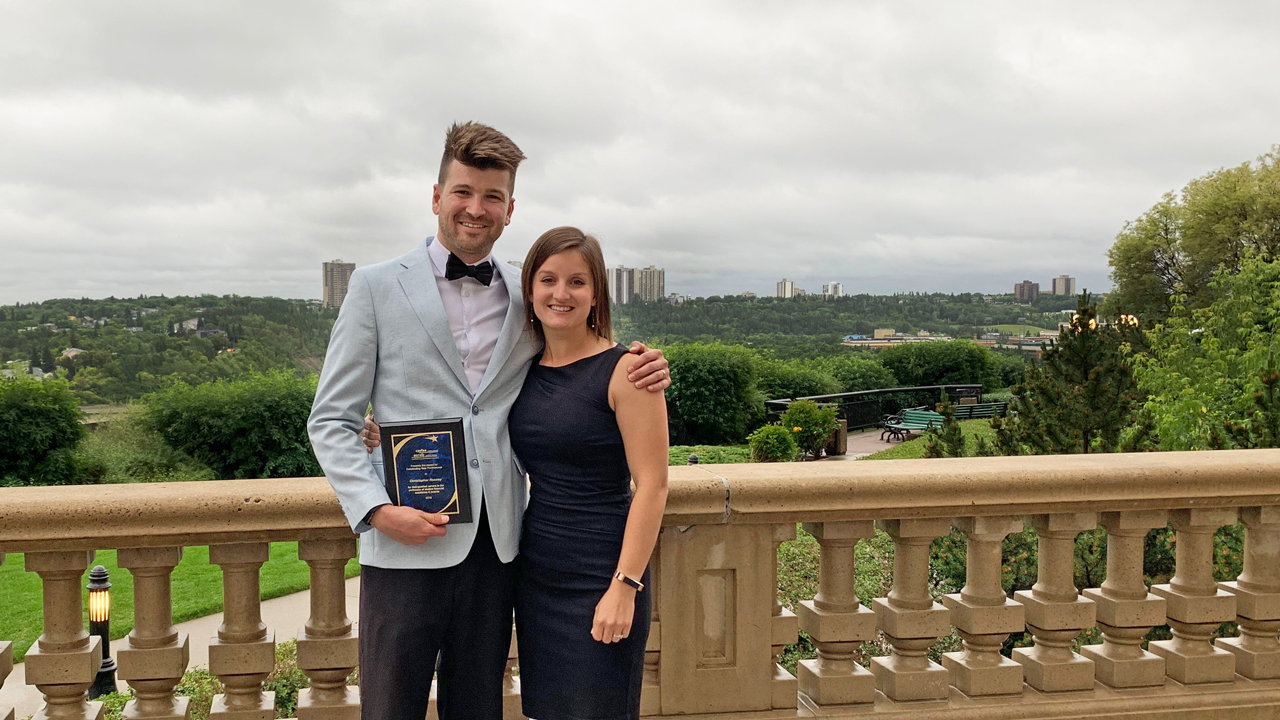 Christopher Rooney poses for a photo alongside Amanda Moreton with CASFAA Award in hand.