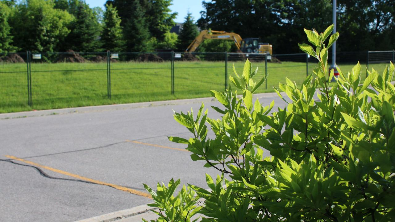 Digging begins at north lot of campus with excavator
