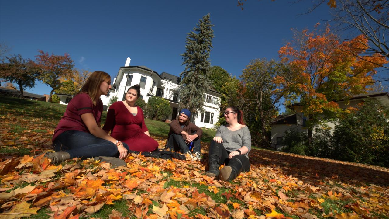 Trent students on the downtown Traill College campus outside of Scott House