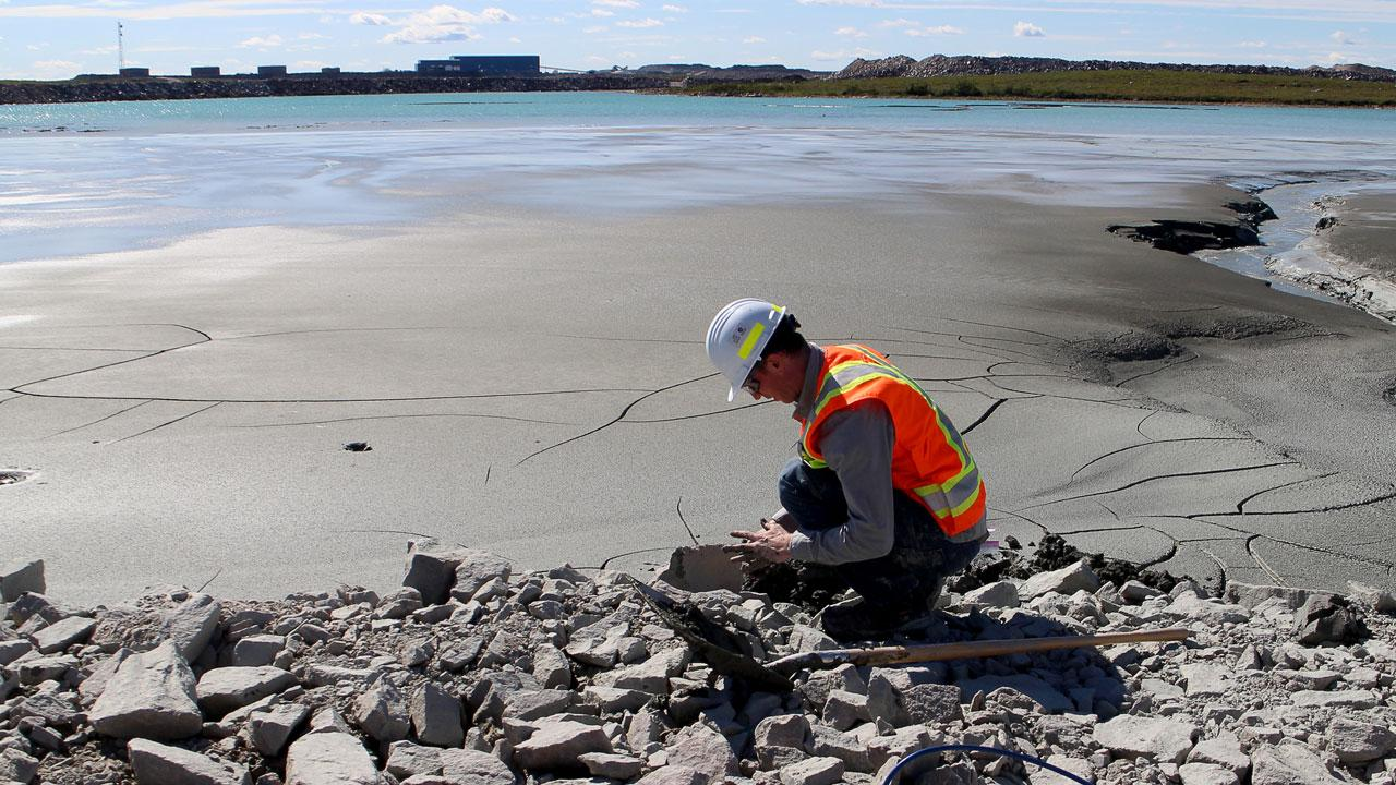 Trent University assistant professor Dr. Ian Power collects mine tailings from the De Beers' Gahcho Kué Diamond Mine in the Northwest Territories.