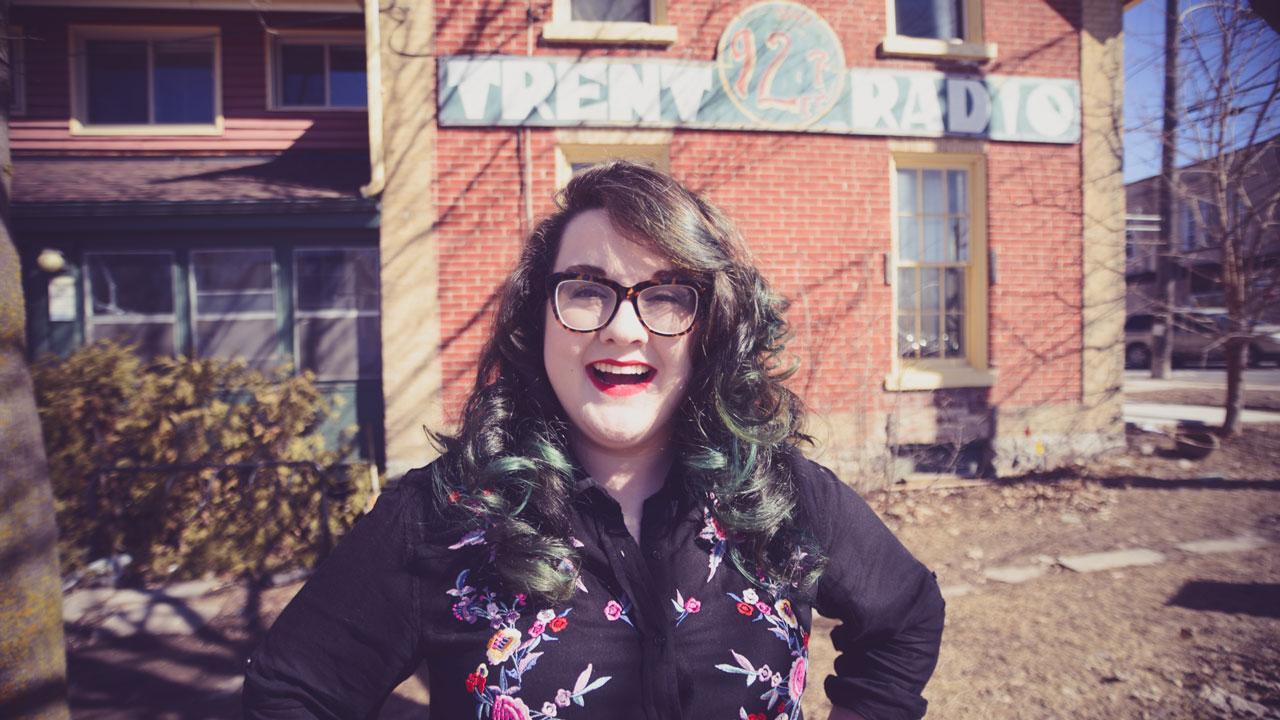 Angelica Cooper standing in front of Trent Radio