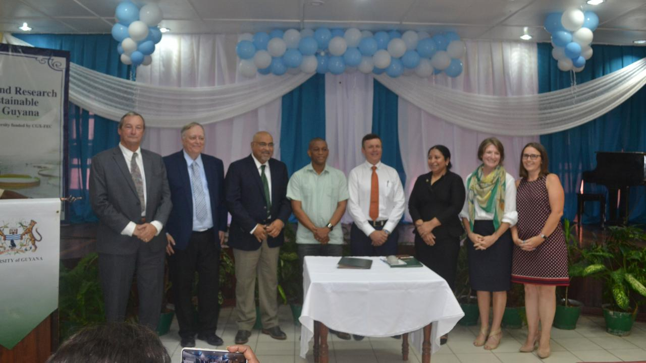 Representatives from each of the program's partners announce the launch of the initiative in Guyana.