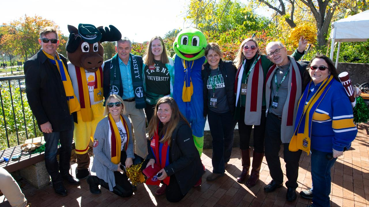 Trent University leaders, alumni, staff and faculty gathered for the announcement of the Campaign for Trent Colleges alongside college mascots.