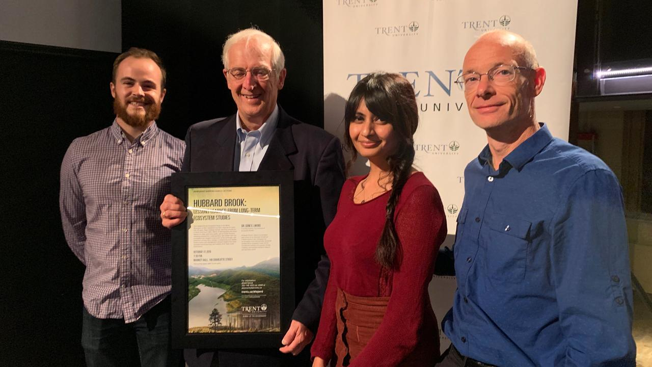 From left: Trent student Patrick Levasseur, Dr. Gene Likens, Trent student Batool Syeda and Director of the Trent School of Environment Shaun Watmough.