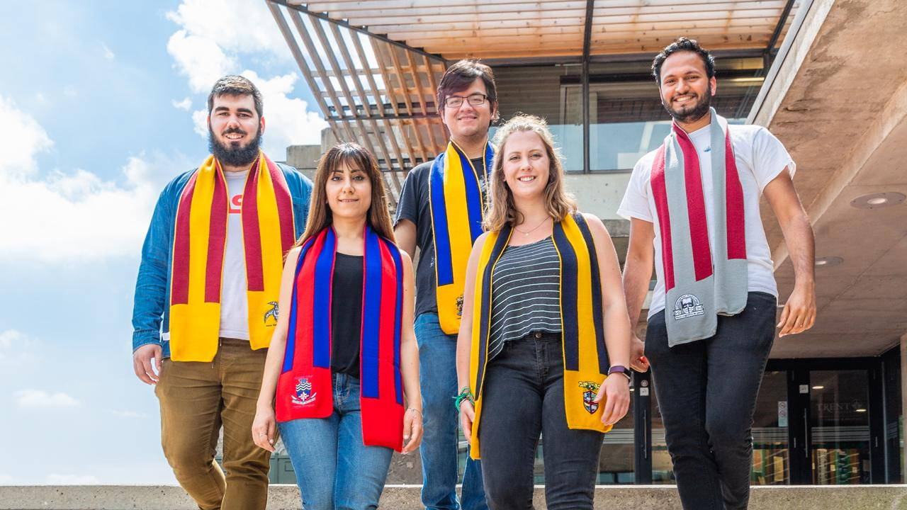 Trent University students wearing their college scarves.